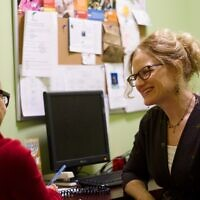Shay Port, right, meets with a client during a financial coaching session. Photo by Christopher Kendall