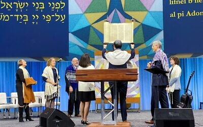 abbi David Maxa from Prague, Czech Republic, receiving his synagogue's first Torah. The Torah was previously used by URJ Camp Kutz. Photo provided by Dale Lazar