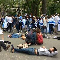 Anti-Israel protestors infiltrate a Yom HaAtzma'ut celebration of New York University students in Washington Square Park. (Photo by Toby Tabachnick)