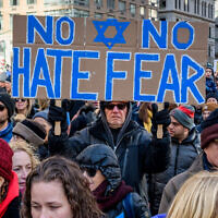 MANHATTAN, NEW YORK, UNITED STATES - 2020/01/05: Participant holding a sign at the rally. Thousands of New Yorkers of all backgrounds joined community leaders and city and statewide elected officials in Foley Square at the No Hate. No Fear. solidarity march in unity against the rise of anti-semitism.  (Photo by Erik McGregor/LightRocket via Getty Images)