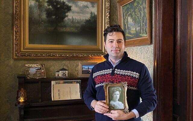 Matthew Falcone holds a photo of Pauline Hanauer Rosenberg (Photo by Toby Tabachnick)