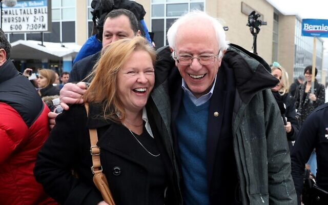 Democratic presidential candidate Bernie Sanders and wife Jane walk together after greeting his campaigners outside a polling station in Manchester, New Hampshire, Feb. 11, 2020. Photo byJoe Raedle/Getty Images via JTA