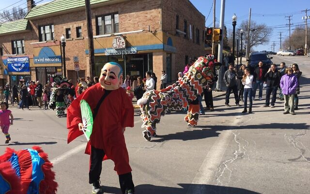 Participants and performers gather in Squirrel Hill during 2016 Lunar New Year parade. Photo by Jim Busis