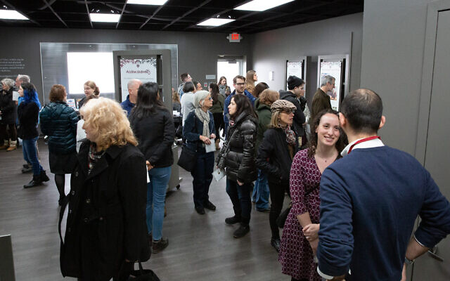 Nearly 100 people attended the opening event. Photo by Melanie Wieland, courtesy of the Holocaust Center of Pittsburgh