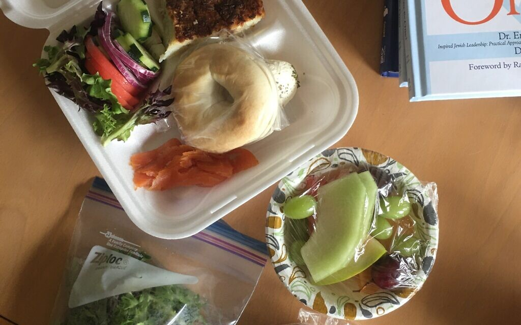 Nathan Jeffay misses the simple pleasure of kiddush, like those at Beth Shalom Congregation, before social distancing and individually wrapped lunches.   Photo courtesy of Tammy Hepps