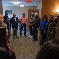 Community members gathered at the 10.27 healing partnership in February 2019 for a mezuzah hanging ceremony. Photo courtesy of Maggie Feinstein