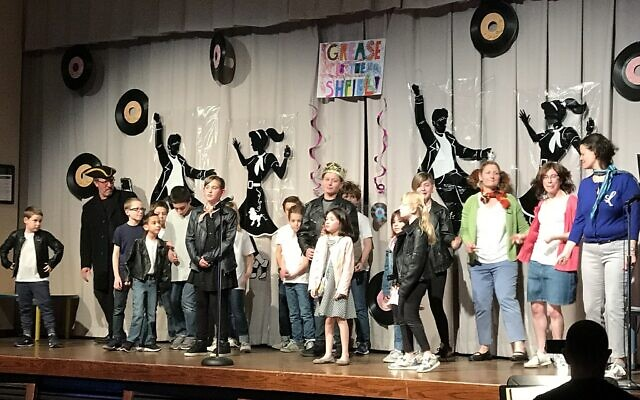 "Students from Temple Emanuel and Beth El Congregation perform a parody of ""Grease"" for Purim, 2018.  Photo by Rob Goodman"