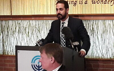 Josh Sayles, former chair of the Jewish Federation of Greater Pittsburgh's Community Relations Council, addresses reporters at a press conference in support of Asian Americans in 2020. (Photo by Justin Vellucci)