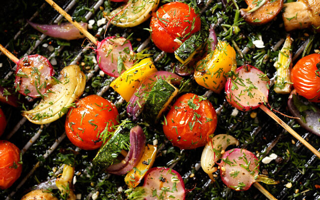 Grilled veggie skewers with cherry tomatoes, radishes, peppers and onions with fresh dill on a grill pan. Photo by zi3000/iStockphoto.com