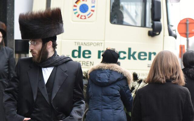 Haredi Orthodox Jews walk in Antwerp, Belgium, March 16, 2016. Photo by Cnaan Liphshiz