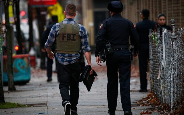 A FBI officer arrives at the scene of an active shooting in Jersey City, N.J., Dec. 10, 2019.Photo by Kena Betancur/AFP via Getty Images)