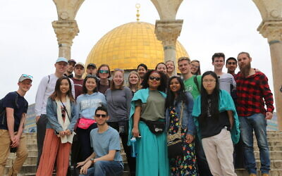 Alex Zissman (bottom row, seated) has been named the Jack Buncher Director of Jewish Student Life at CMU. Zissman led 25 Jewish CMU undergraduate Hillel student leaders and non-Jewish campus student leaders exploring Israel and the Palestinian Territories. Photo provided by Alex Zissman.