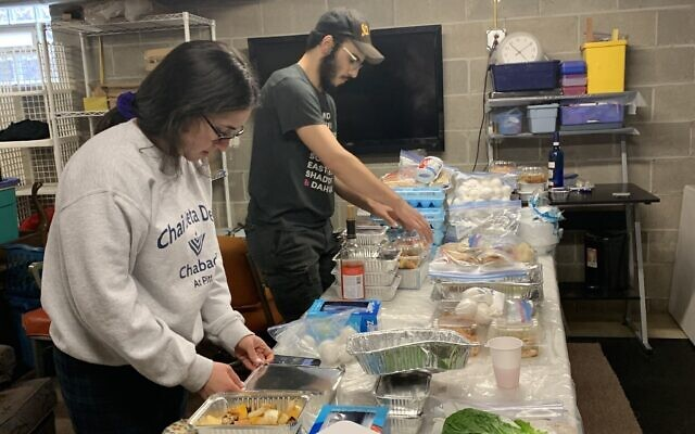 Shira and Mendy Weinstein assemble Passover foods to distribute  to students. Photo provided by Sara Weinstein