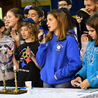 CDS 8th graders participate in a Kabbalat Shabbat service prior to the pandemic.   Photo courtesy of Community Day School