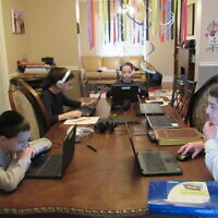The Berelowitz children were fully engaged in their virtual classrooms at Hillel Academy of Pittsburgh last semester. Photo courtesy of Hillel Academy of Pittsburgh