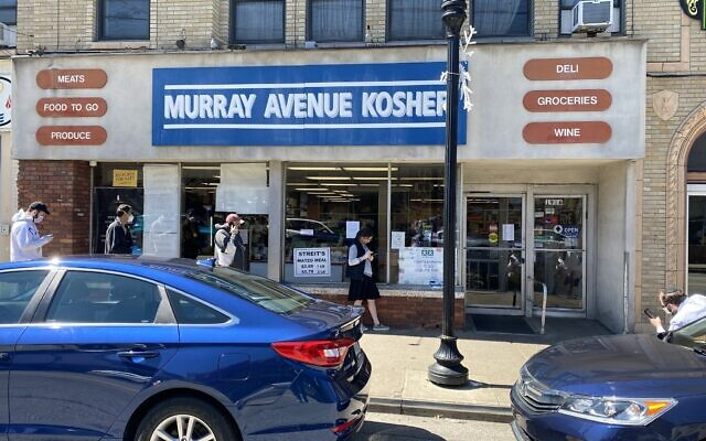 Shoppers wait in line, six feet apart, to enter Murray Avenue Kosher.  Photo by Jim Busis