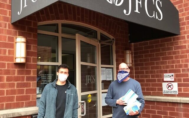 Ezra Gershanok delivers face masks to Jordan Golin of JFCS