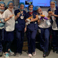 Health care professionals at New York-Presbyterian Hospital enjoy kosher pizza delivered by Kosher19. Photo via JNS.org