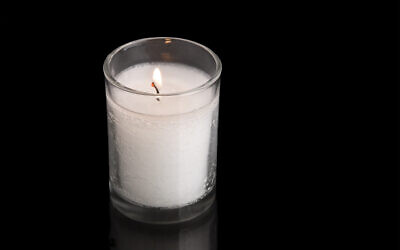 A custom in Judaism is to kindle a light on the anniversary of the death of a loved one. This special light is traditionally a thick wax candle held inside a clear, glass jar. Photo by leah613 / via Istockphoto.com