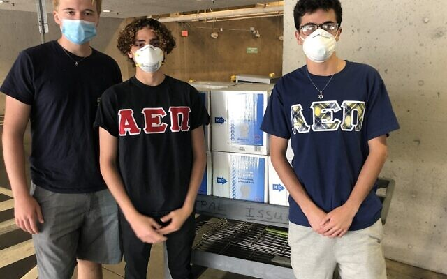 AEPi brothers Raphael Eidelman, Tal Ankori and Noah Ben David pick up supplies for Jewish Family Services in Los Angeles.Courtesy photo via JNS.org
