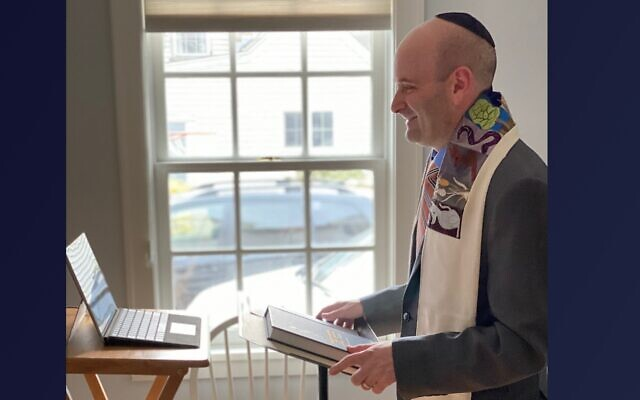 Rabbi Danny Burkeman of the Reform synagogue Temple Shir Tikvah in Wayland, Mass., leads services from his home. Now Conservative synagogues will also be allowed to livestream on Shabbat services following certain parameters. (Courtesy of Burkeman)