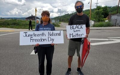 Dee and Walt Kochirka, of the South Hills, traveled to Hazelwood to celebrate Juneteenth. Photo by Adam Reinherz