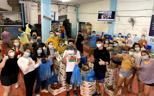 Year Course students this spring wear masks while volunteering.  Photo courtesy of Year Course
