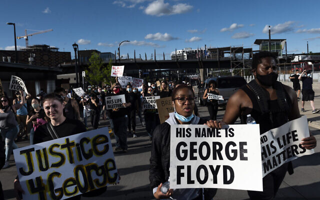 Protesters in Minneapolis, Minnesota, demonstrated against the death in police custody of George Floyd, May 29, 2020. (Stephen Maturen/Getty Images via JTA.org)