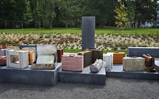Stylized pieces of luggage stand at a memorial for deported Jews in front of the main station in Wurzburg, Germany. The abandoned suitcases are intended to symbolize the loss and disappearance of Jews and their religious communities during the Nazi era. Photo by Karl-Josef Hildenbrand/picture alliance via Getty Images via JTA