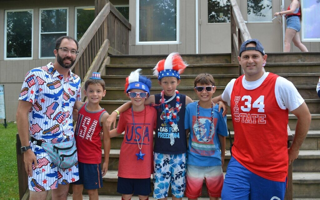 Director of Emma Kaufmann Camp, Aaron Cantor (left), campers, and  Brooks Weaver, EKC's assistant camp director on July 4, 2019. (Photo provided by Aaron Cantor)