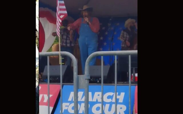 Comedian Sacha Baron Cohen performed a song with racist and conspiracy theory-laden lyrics at a far-right rally in Olympia, Washington, June 27, 2020. (Screenshot from YouTube)