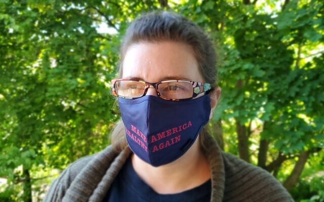 One of the facemasks developed by Marc Tobias plays on a phrase familiar to those that follow politics. Photo by David Rullo
