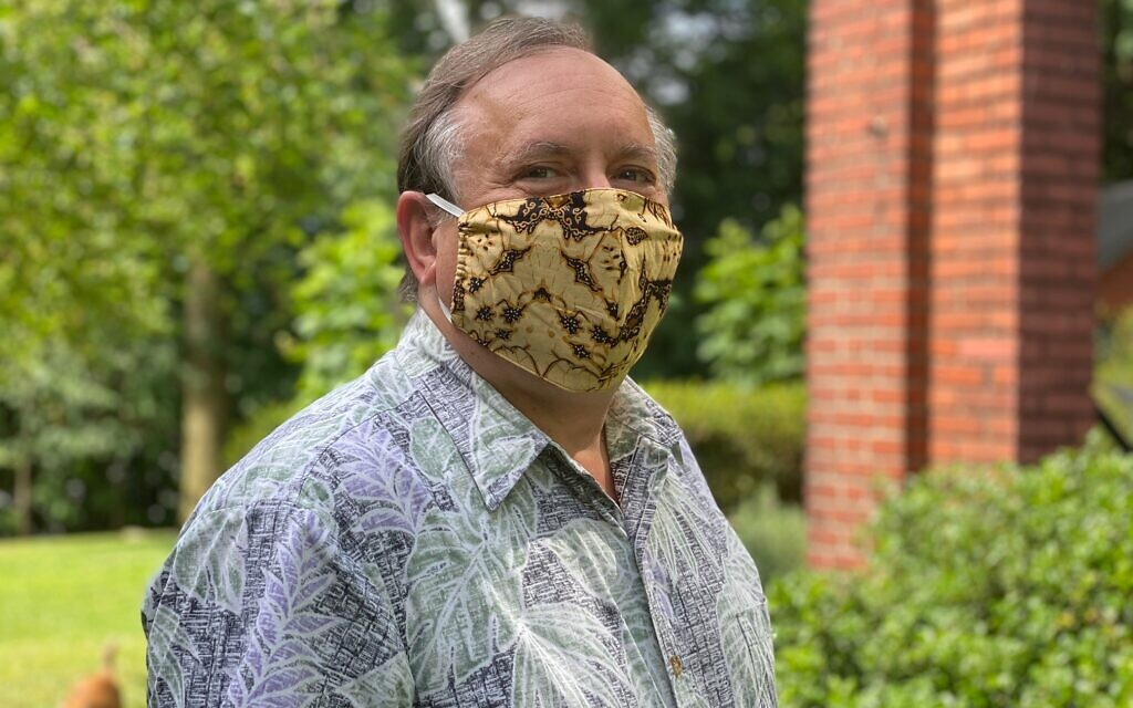 Jim Busis sports a face mask made from Indonesian batik. Photo by Maureen Kelly Busis.