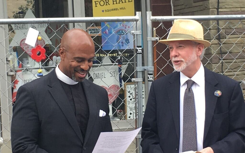 Pastor Eric Manning and Rabbi Jeffrey Myers gather outside the Tree of Life building in 2019. Photo courtesy of Tree of Life