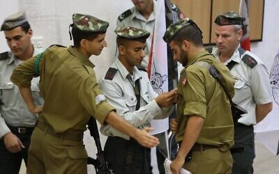 Yitzy Nadoff receives the Combat Medic Pin while serving in the IDF. (Photo provided by Yitzy Nadoff)