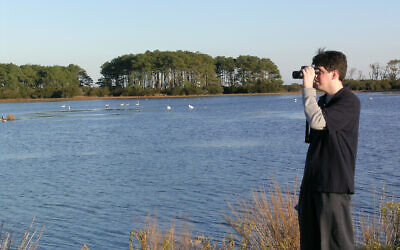 Ryan Tomazin birding in Chincoteague. Photo courtesy of Ryan Tomazin