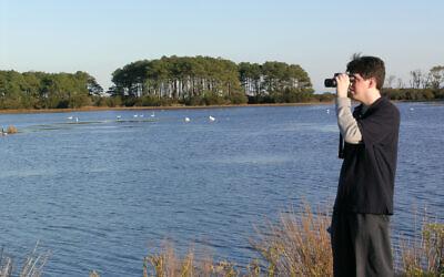 Ryan Tomazin birding in Chincoteague. Photo courtesy of Ryan Tomazin