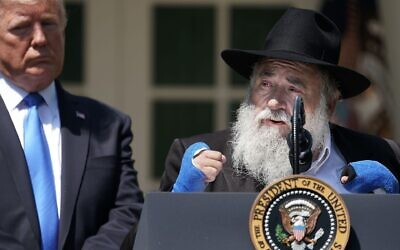 U.S. President Donald Trump (L) listens to Congregation Chabad Rabbi Yisroel Goldstein of Poway, California, speak during a National Day of Prayer service in the Rose Garden at the White House in Washington, DC on May 02, 2019. (JTA/Chip Somodevilla/Getty Images)