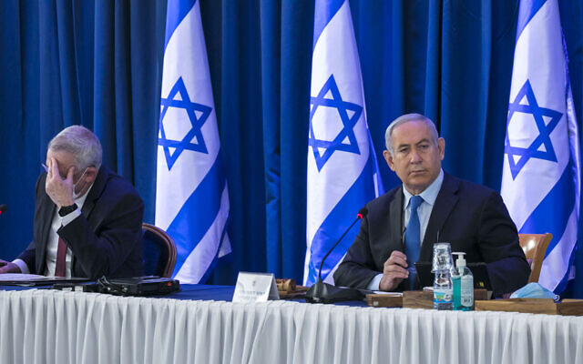 Israeli prime minister Benjamin Netanyahu, right, and Defense Minister Benny Gantz at a meeting at the Ministry of Foreign Affairs in Jerusalem, June 28, 2020. (JTA/Olivier Fitoussi/Flash90)