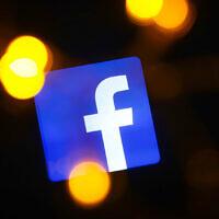 Facebook logo is displayed on a mobile phone screen (Photo by Beata Zawrzel/NurPhoto via JTA)