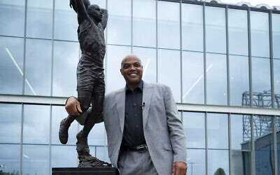 Charles Barkley poses for a picture with his sculpture at the Philadelphia 76ers training facility Sept. 13, 2019 in Camden, New Jersey. (JTA/Mitchell Leff/Getty Images)