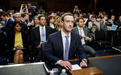 """BEIJING, April 10, 2018:  Facebook CEO Mark Zuckerberg (C) testifies at a joint hearing of the Senate Judiciary and Commerce committees on Capitol Hill in Washington D.C., United States, on April 10, 2018. Facebook CEO Mark Zuckerberg told Congress in written testimony on Monday that he is """"responsible for"""" not preventing the social media platform from being used for harm, including fake news, foreign interference in elections and hate speech. (Xinhua/Ting Shen via Getty Images)"""