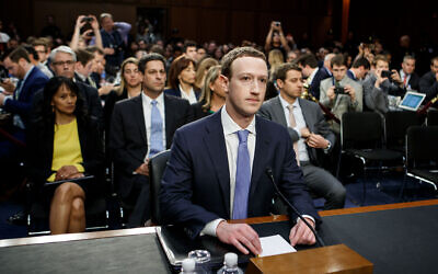 "BEIJING, April 10, 2018:  Facebook CEO Mark Zuckerberg (C) testifies at a joint hearing of the Senate Judiciary and Commerce committees on Capitol Hill in Washington D.C., United States, on April 10, 2018. Facebook CEO Mark Zuckerberg told Congress in written testimony on Monday that he is ""responsible for"" not preventing the social media platform from being used for harm, including fake news, foreign interference in elections and hate speech. (Xinhua/Ting Shen via Getty Images)"