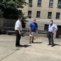 Rabbi Yossi Rosenblum, left, and Rabbi Chezky Rosenfeld, right, meet with a tent supplier to discuss the possibilities of outdoor instruction. Photo courtesy of Rabbi Yossi Rosenblum