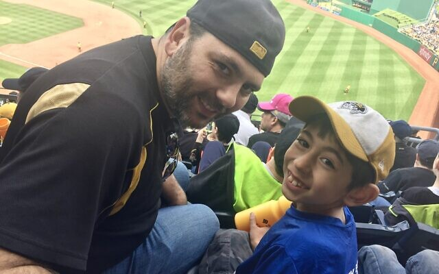 Elan Sokol with his son Zishe at PNC Park in 2017. Photo courtesy of Elan Sokol.