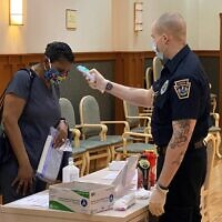 JAA employee gets screened for COVID-19 symptoms. Photo provided by the JAA.