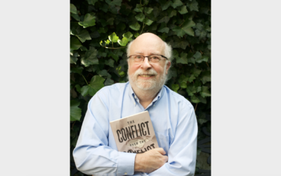 "Kenneth Stern with a copy of his book ""The Conflict over the Conflict."" Photo by Emily Stern."