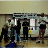 Jimmy Goldman, right, and Sherree Hall, second to right, at the 1994 JCC Indoor Triathlon. Photo courtesy of Rauh Jewish History Program & Archives
