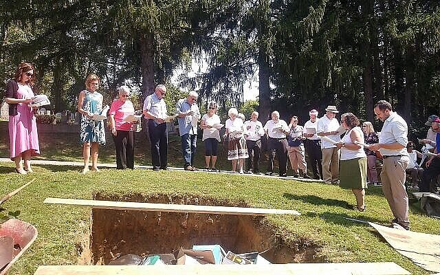 Staff writer David Rullo won a Rockower Award for his feature on Temple Beth Am of Monesson ending its 50 year legacy with a ceremony burying its prayer books.