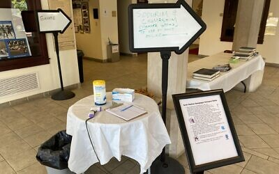 A safety station set up at the entrance of Beth Shalom to help keep members healthy as they return to services (Photo by Jim Busis)